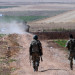 Turkish soldiers patrol near the border with Syria, ouside the village of Elbeyli, east of the town of Kilis, southeastern Turkey, Friday, July 24, 2015. Turkish warplanes struck Islamic State group targets across the border in Syria early Friday, government officials said, a day after IS militants fired at a Turkish military outpost, killing a soldier. The bombing is a strong tactical shift for Turkey which had long been reluctant to join the U.S.-led coalition against the extremist group. (AP Photo)