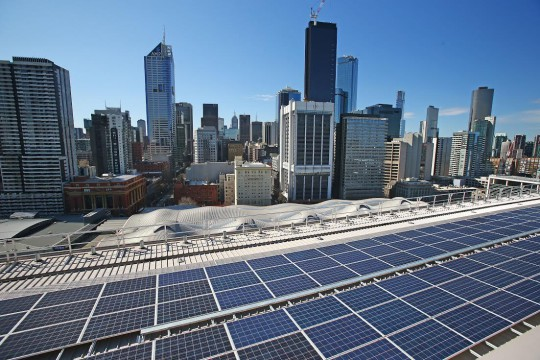 MELBOURNE, AUSTRALIA - AUGUST 20: Solar panels are seen on the rooftop at AGL's new Docklands office on August 20, 2015 in Melbourne, Australia. The rooftop solar system covers 20,000 square metres and will generate an estimated 110,000 kWh of electricity a year. Opposition Leader Bill Shorten has announced Labor's plans for a 50 per cent renewable energy target. (Photo by Scott Barbour/Getty Images)